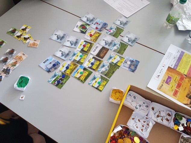 Village life board game showing the tiles, buildings and pieces